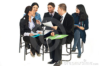Happy team having conversation at seminar