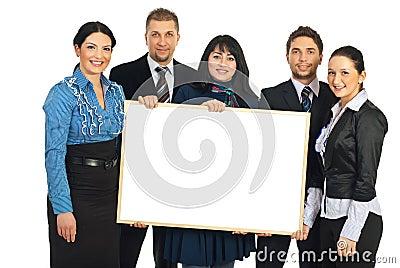 Happy teamwork holding blank banner