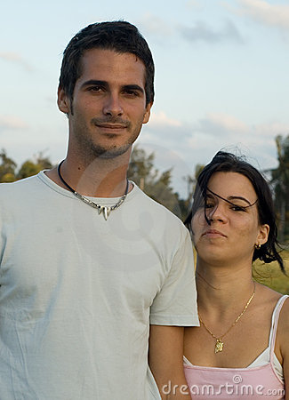 Happy teen couple outdoors