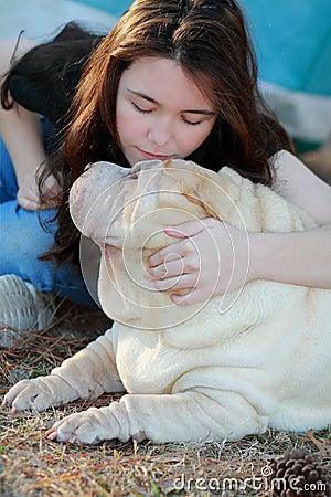 Happy teen girl and dog love
