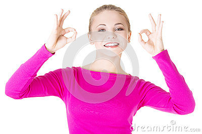 Happy teen girl gesturing perfect