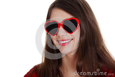 Happy teen girl in heart-shape sunglasses