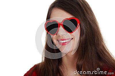 Happy teen girl in heart-shape sunglasses