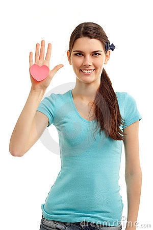 Happy teen girl holding in hand heart