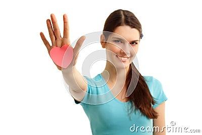 Happy teen girl holding in hand heart