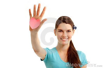Happy teen girl holding in hand heart love