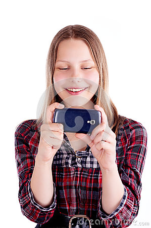Free Happy Teen Girl Laughing And Use Mobile Phone Royalty Free Stock Images - 41584959