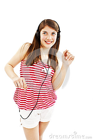 Happy teen girl listening to music