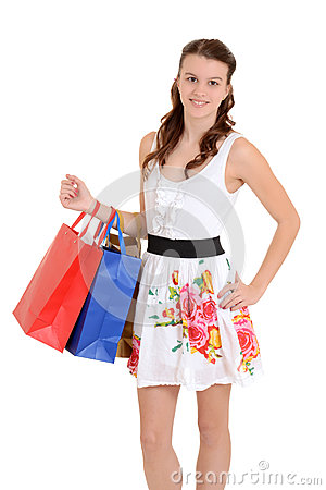 Happy teen girl with shopping bags
