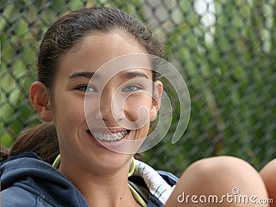 Happy teen girl smiling