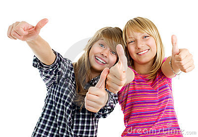 Happy teen girls showing thumbs up