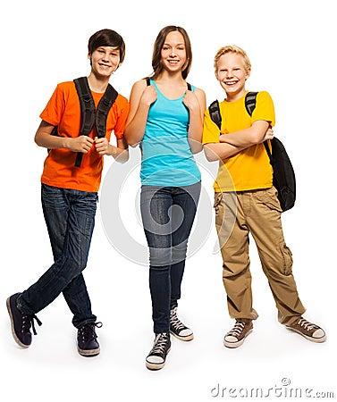 Happy teen kids with backpacks