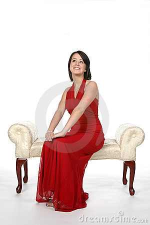 Happy teen in red gown