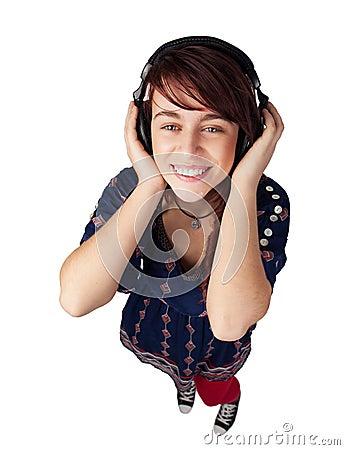 Happy teen woman listening music