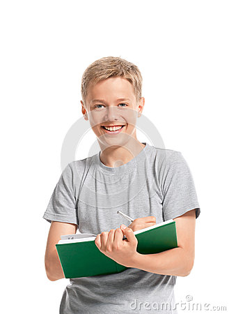 Free Happy Teenage Boy Writes Something In A Notebook Royalty Free Stock Photo - 33982915