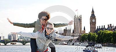 Happy teenage couple having fun over london city Stock Photo