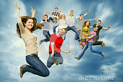 Happy teenage friends jumping in the sky