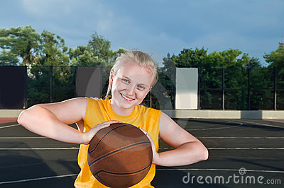 Happy teenage girl with basketball
