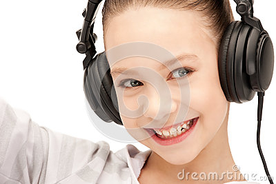 Happy teenage girl in big headphones Stock Photo