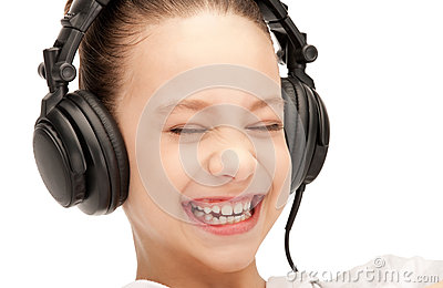 Happy teenage girl in big headphones Stock Photo