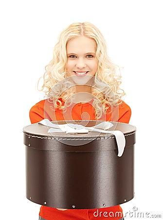 Happy teenage girl with gift box Stock Photo
