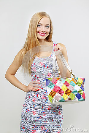 Happy teenage girl with handbag