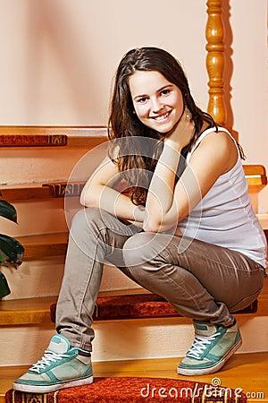 Happy teenage girl at home