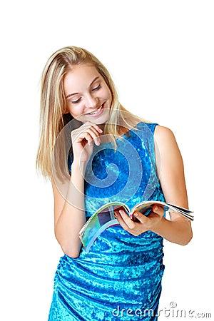Happy teenage girl looking on journal