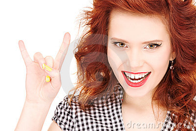 Happy teenage girl showing devil horns gesture