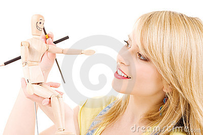 Happy teenage girl with wooden model dummy