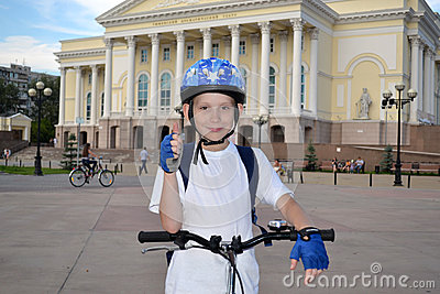 The happy teenager by bicycle near the Tyumen drama theater.