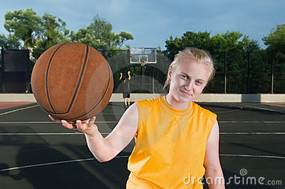 Happy teenager girl with basketball
