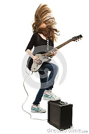 Happy teenager girl playing guitar