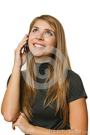 Teenager girl talking on mobile phone and looking up
