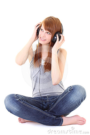 Happy teenager with headphones sitting