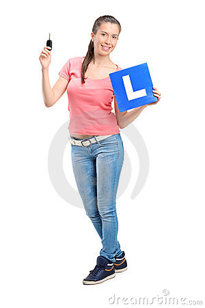 Happy teenager holding a car key and L plate
