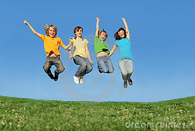 Happy teenagers jumping