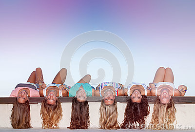 Happy Teens With Long Healthy Hair Laying Upside Down