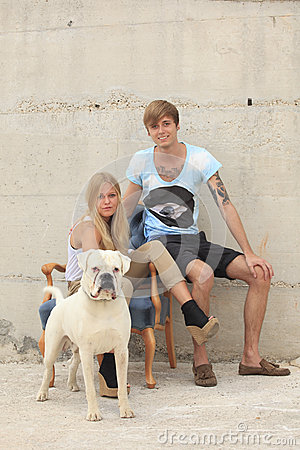 Happy teens wit their dog
