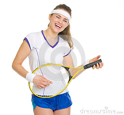Happy tennis player playing on racket as on guitar