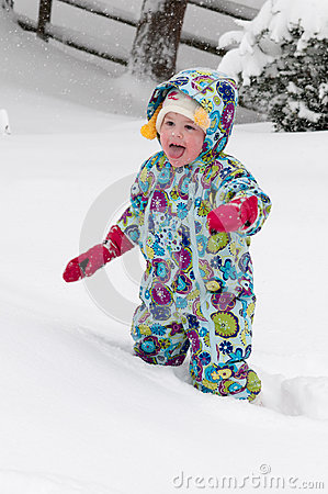 Free Happy Toddler Girl In Warm Coat And Knitted Hat Tossing Up Snow And Having A Fun In The Winter Outside, Outdoor Portrait Royalty Free Stock Photography - 97968467