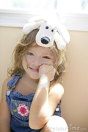 Free Happy Toddler Girl With Toy Dog Over Head Stock Photography - 8711902