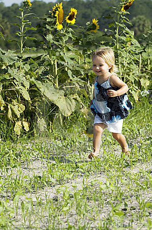 Happy toddler running in field