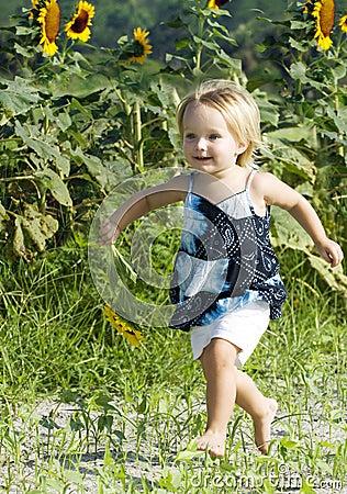 Happy toddler running in field