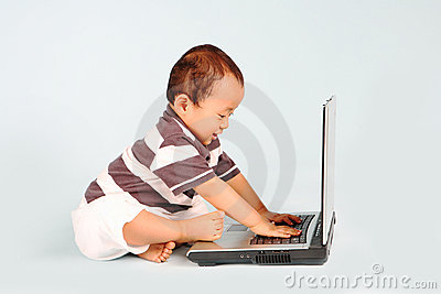Happy Toddler Using a Laptop