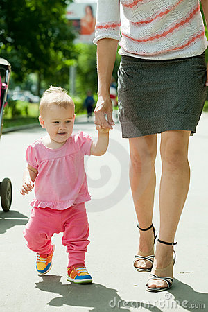 Happy toddler walking on road
