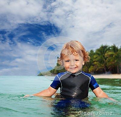Happy toddler in wet suit