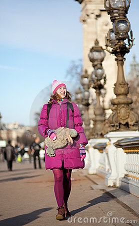 Happy tourist girl with funny bag in Paris