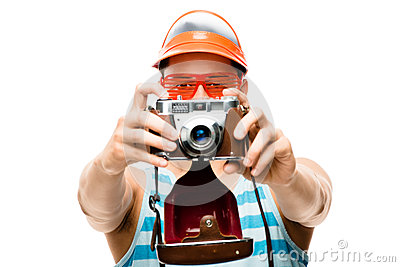 Happy tourist photographer taking photo
