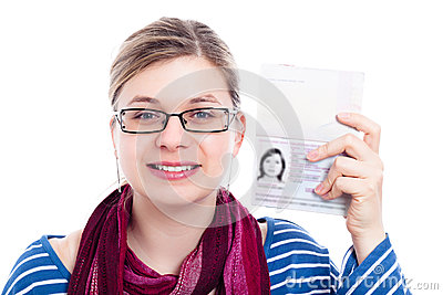 Happy tourist traveller woman with passport